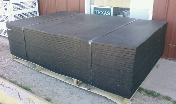 Pallet of horse stall mats at a feedstore