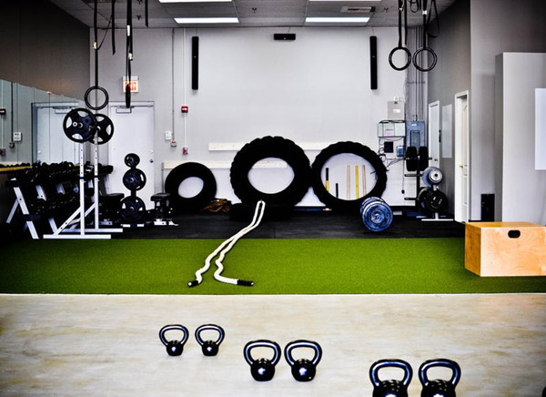 Astroturf garage gym! Definitely Crossfit central