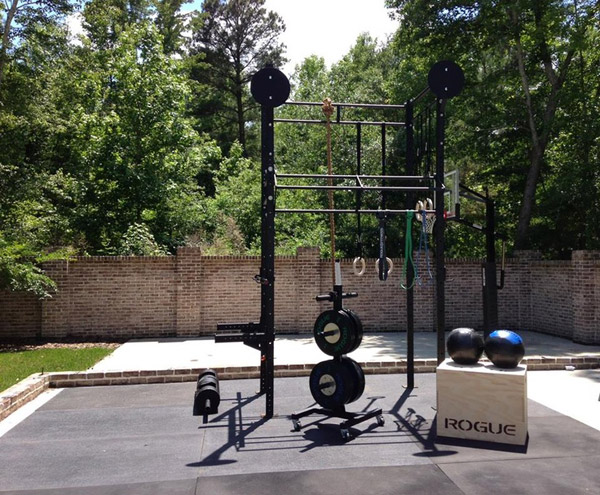 Sweet Rogue outdoor setup - huge power rack, bumper plates, you name it