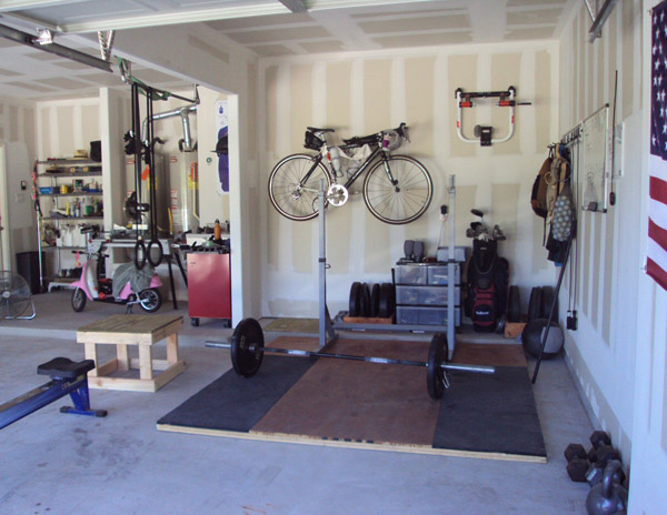 Nice garage gym tucked away in one bay.