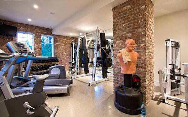Nice home gym studio with machines, rack and punching bag