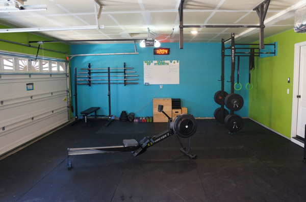 Fully committed garage gym - All the essentials - bars, rack, rower, bumper plates
