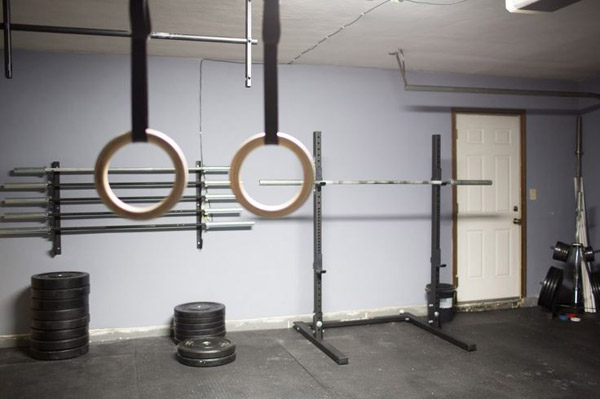kick ass garage gym with lots of bars