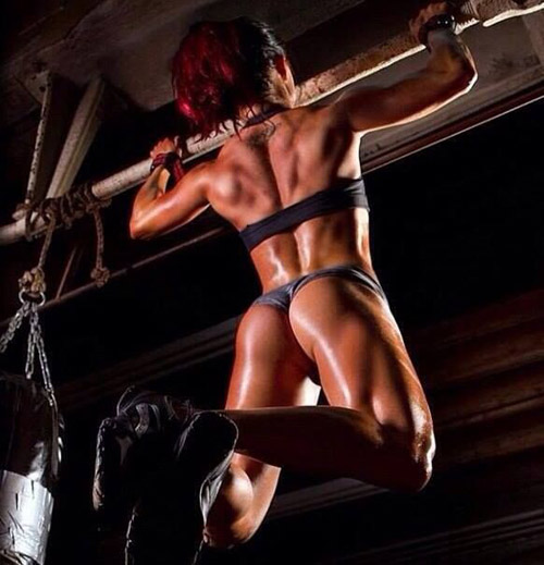 Gorgeous, fit redhead doing some chin-ups. Great legs, great butt, and super strong back. Work out, folks! #fitsbo