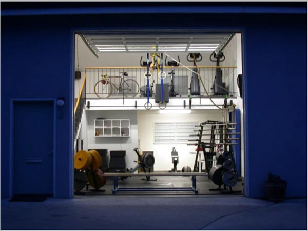 Amazing two tier garage gym with all the right exercise equipment