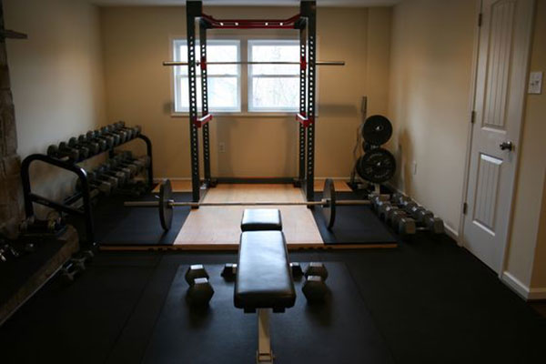 Fully equipped Oly gym with dumbbells, platform, and plenty of space