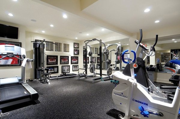 Big home gym with futuristic looking cardio machines