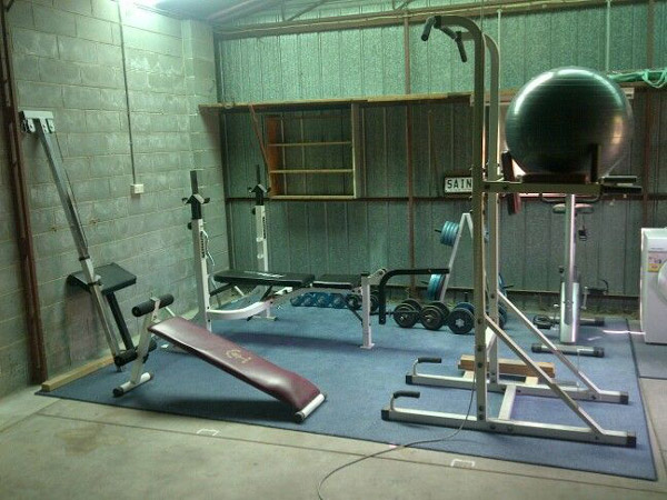 very cool compact garage gym with a classic cinder block feel