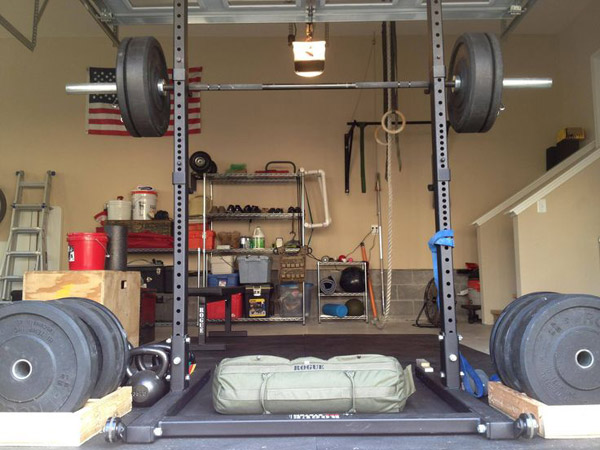 Bumper plates, sand bags, squat stand.. great gym