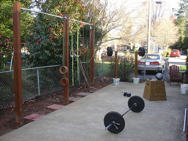 Outdoor gym, probably a back yard gym. Lots of DIY. Very well done pull-up rig and squat stand. Get your workout done at home on the cheap