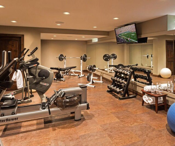 This upscale basement gym has a water rower - how fun!