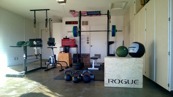 Check out the padding on the GHD... Camo! Nice garage gym.