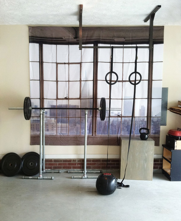 Another DIY home gym. I can't decide if the fake window is tacky or cool. It's kind of a neat idea