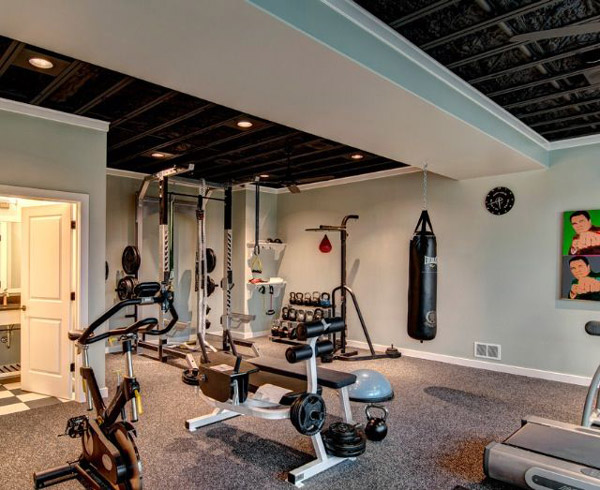 Interesting basement gym - nice ceiling. Lots of really cool gear