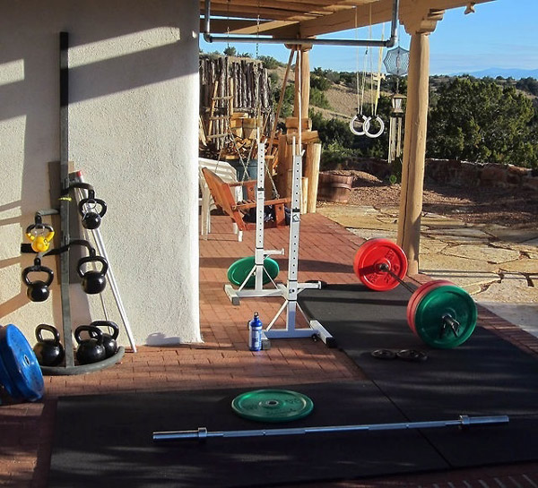 Killer back yard gym - colored bumper plates, kettlebells with nice rack, rings and squat stands