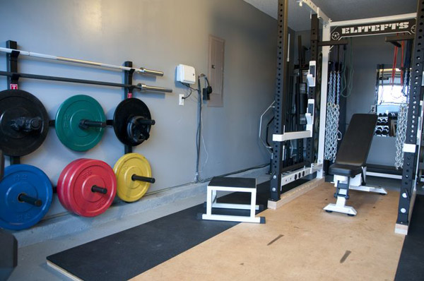 power rack, lifting platform both under and in front of the rack, and crazy clever bar and plate storage