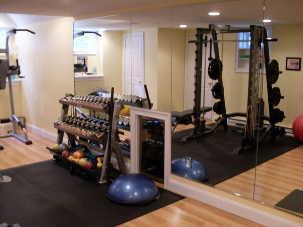 Fancy home gym - check out the mini fridge with water built into the wall. pretty cool