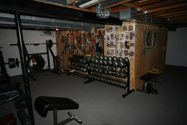 This dark and gloomy basement gym has a hell of a dumbbell collection