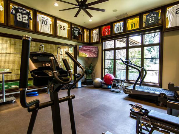 Sports themed home gym with ample space. Seems to have more decoration than equipment. Hopefully it's a work in progress.