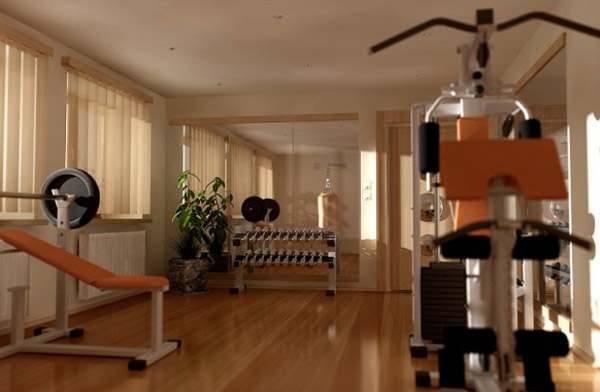 Stylish home gym with complimenting wood floors and equipment pad colors =p