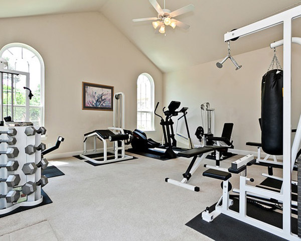 very well equipped home gym with all black on white gear