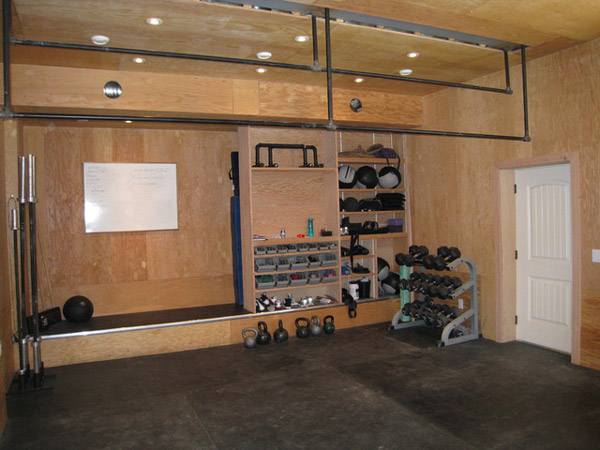 Unfinished traditional garage gym - very organized. where's the power rack