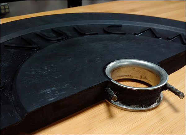 Cross section of a Vulcan 10-lb bumper plate, featuring their exclusive hooked insert