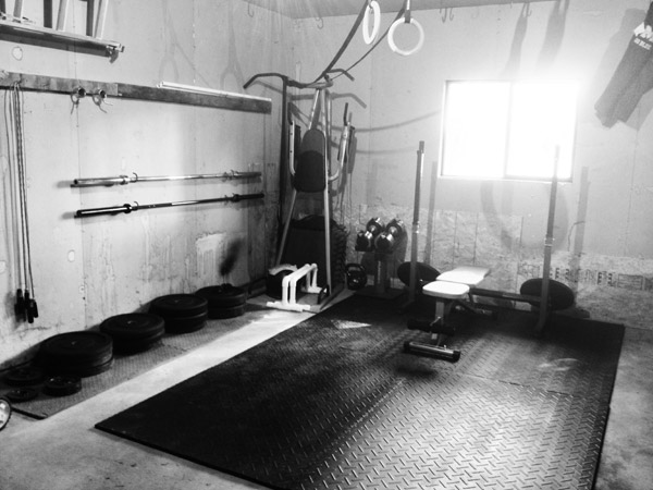 Absolutely beautiful grungy garage gym. All the necessities to go big