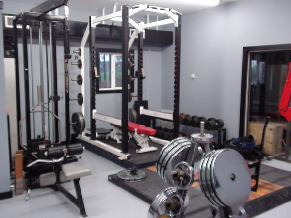 One hell of a Powerlifters garage gym - I love those chrome plated discs