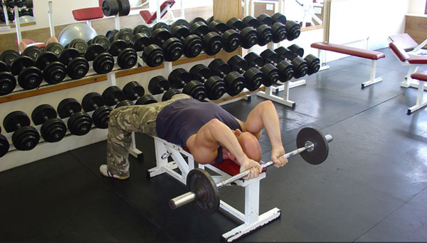 Behind the head lying tricep extension, picture from muscle and strength