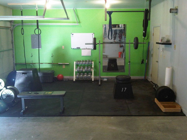 Basic CrossFit garage gym. Does that bar on the wall look bent? #garagegym