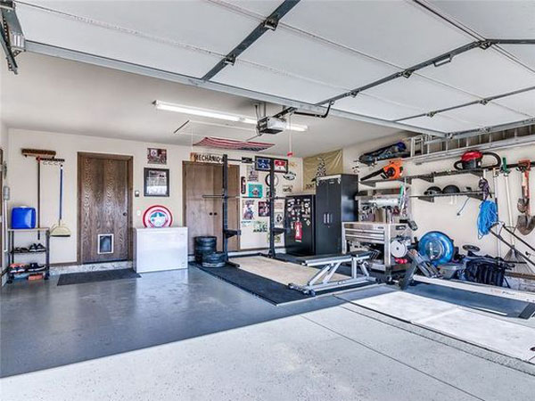 Excellent garage gym. Squat stand, platform, lots of space, and still room for the car