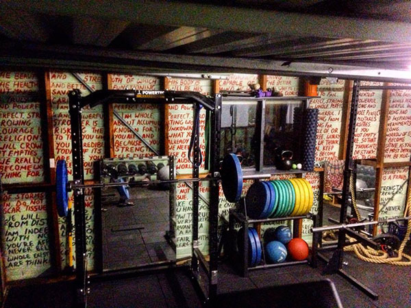 Leo's Powertec economy garage gym with words of inspiration overwhelming the senses