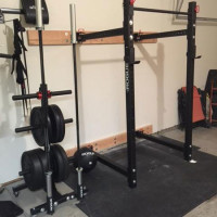 Rogue-equipped garage gym with folding power rack