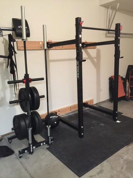 Rogue equipped garage gym with folding power rack