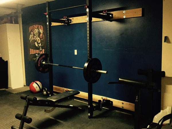 Rogue RML-3W-equipped garage gym. Train away, then fold it up