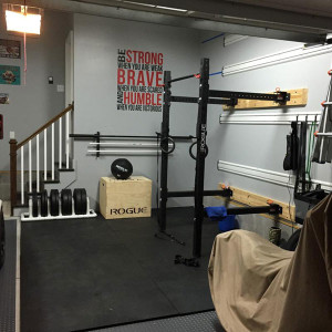 Fully equipped garage gym with space for the car