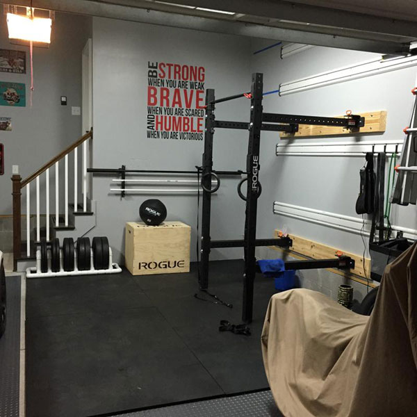 Fully equipped garage gym with space for the car garage gyms