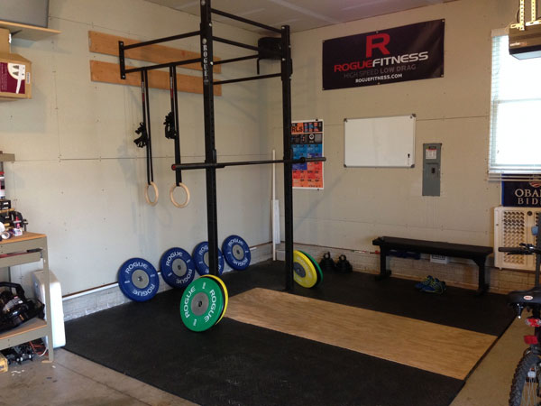 Rogue Wall Rack with well-designed platform. Nice garage gym