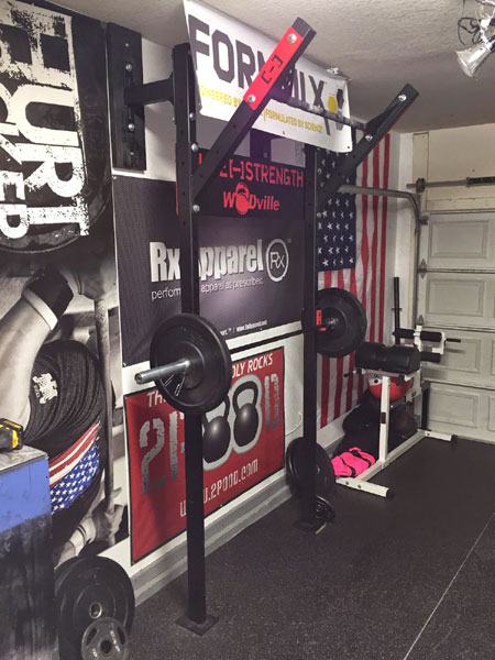 Garage gym with the slim wall rack gyms