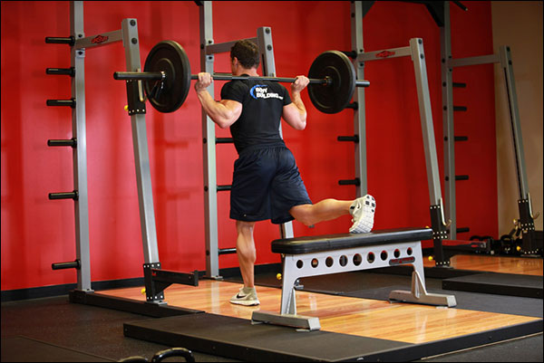 Starting position of the Bulgarian Split Squat (one legged barbell squat) - image courtesy of bodybuilding.com