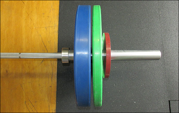 Olympic plates working their way off the bar after each and every rep & drop
