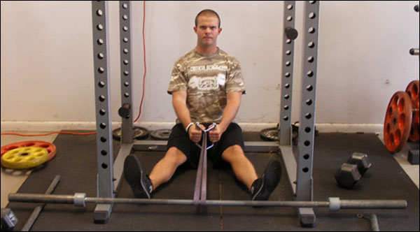 Seated Resistance Band Rows inside a Power Rack