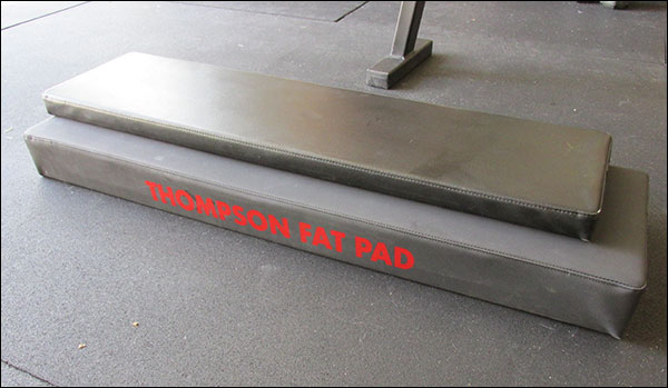 "Size difference between Thompson Fat Pad and standard 12"" x 48"" bench pad (from Rogue Utility)"