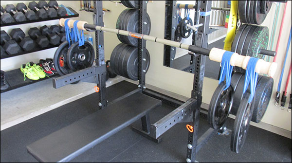 Loading Vulcan's Quad Grip Plates on the Bandbell SuperQuake instead of kettlebells