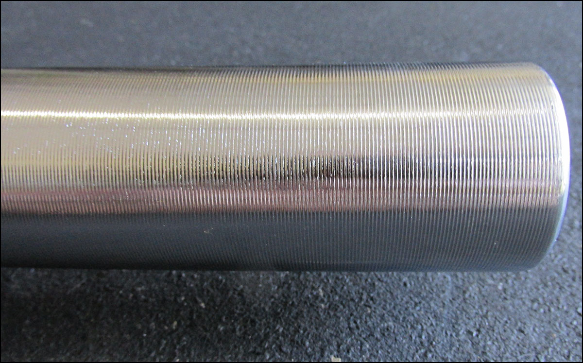 Vulcan Professional Olympic Bearing Bar - grooved sleeves close-up