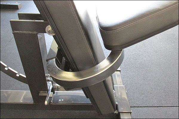 Seat installs behind the back pad using a U-shaped, wrap-around steel tube
