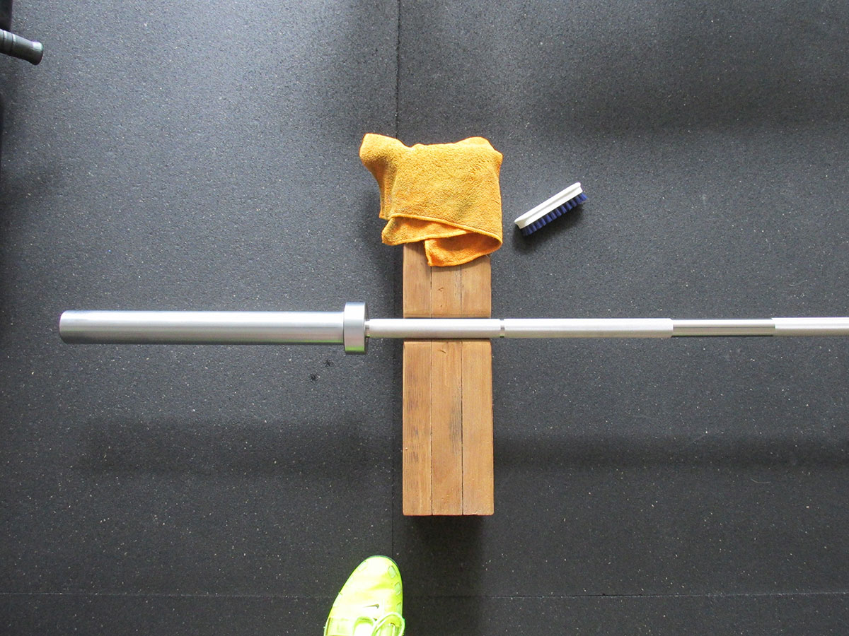 American Barbell Stainless Steel Olympic Bearing Bar clean shaft and sleeves