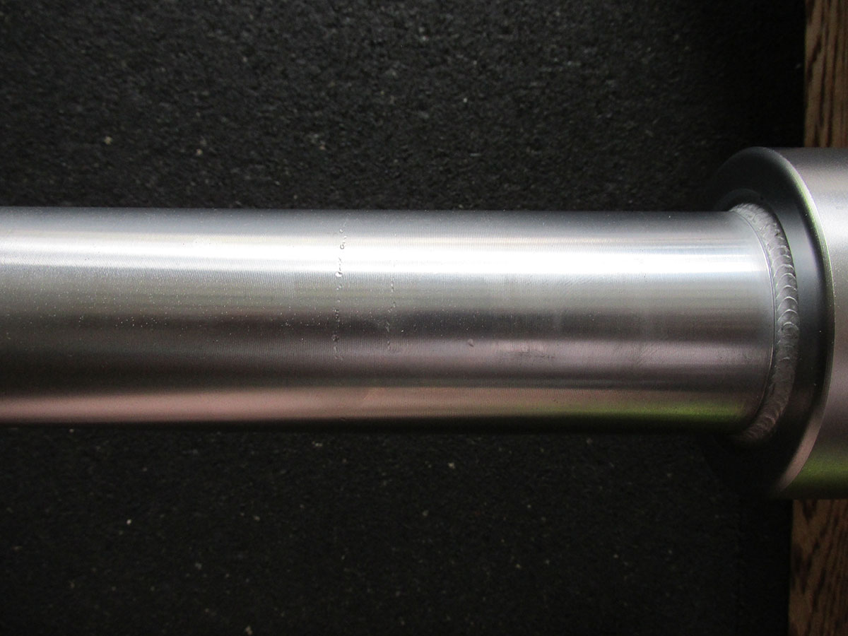 American Barbell SS Oly Bar minor sleeve damage over time close up