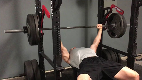 Using the Rogue Monolift Attachment for the bench press eliminates the lift off